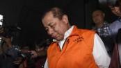 Kepala Balai Pelaksana Jalan Nasional (BPJN) IX Kementerian PUPR Amran HI Mustary mengenakan rompi tahanan KPK. (Antara)